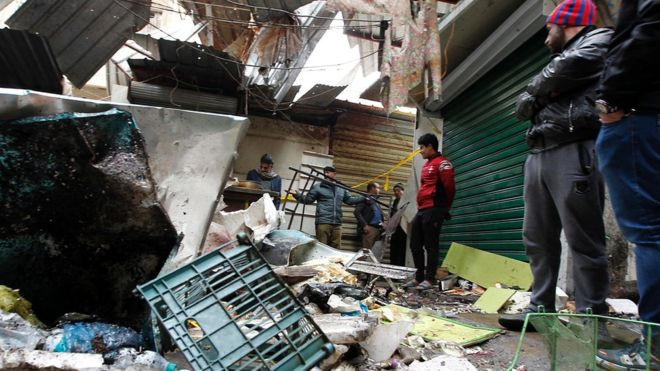 Iraq Baghdad: 28 dead as twin bombs rip through market